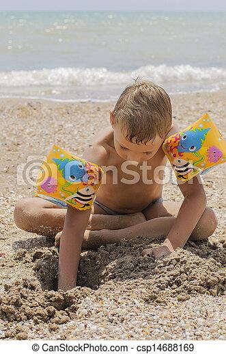 Boy on the beach playing - csp14688169