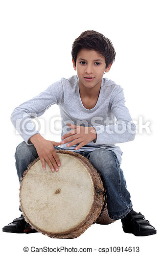 Boy playing a djembe - csp10914613