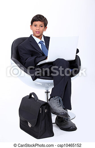 Boy playing at being a businessman - csp10465152