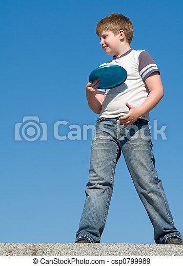 boy playing frisbee - csp0799989