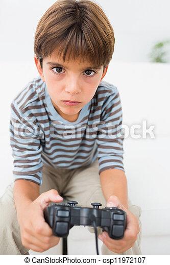 Boy playing video games - csp11972107