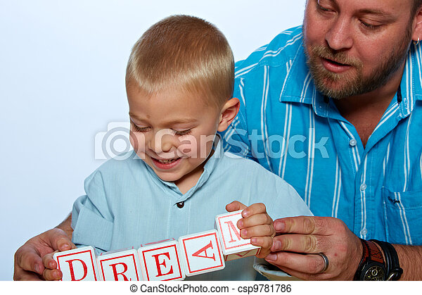 boy playing with alphabet blocks - csp9781786