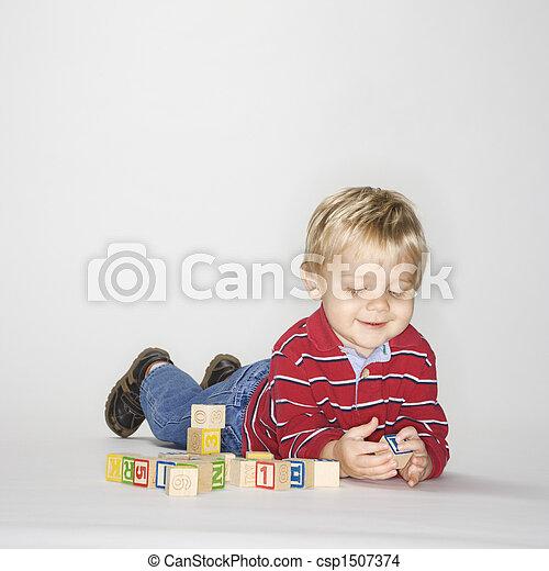Boy playing with blocks. - csp1507374