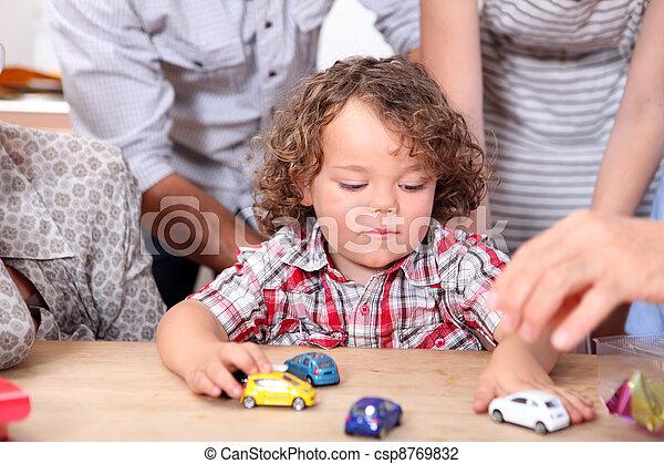 Boy playing with pram - csp8769832