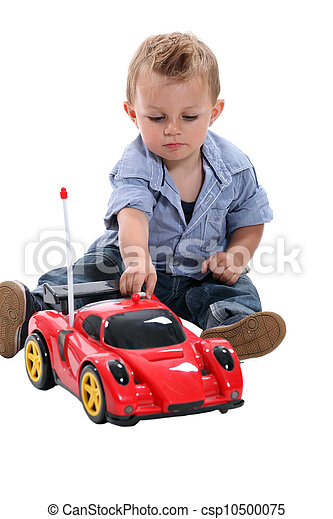 Boy playing with race car - csp10500075