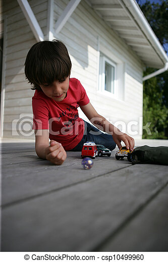 Boy playing with toy cars - csp10499960