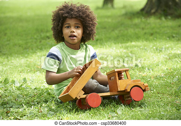 Boy Playing With Wooden Toy Truck - csp33680400