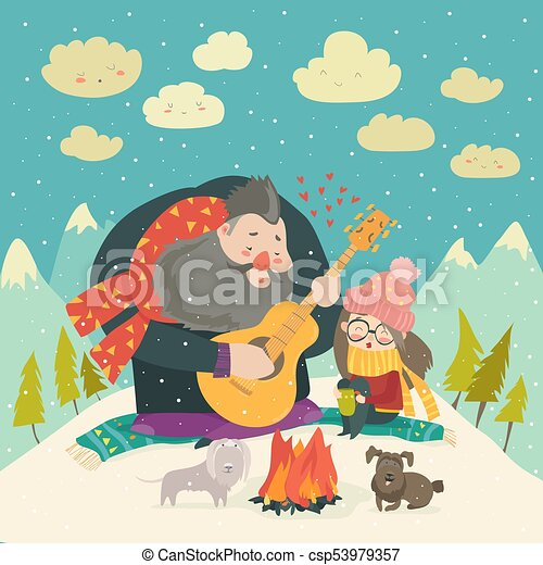 Boy plays guitar for a girl in the winter forest - csp53979357