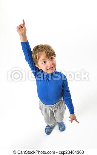 boy pointing upwards - csp23484360