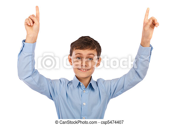 Boy pointing with both hands to the copyspace above - csp5474407