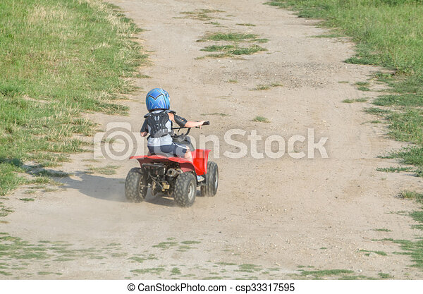 Boy Riding a Quad Bike - csp33317595