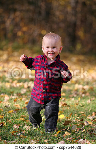Boy running in leaves - csp7544028