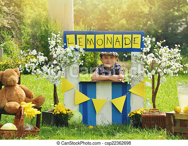 Boy Selling Yellow Lemonade at Stand - csp22362698