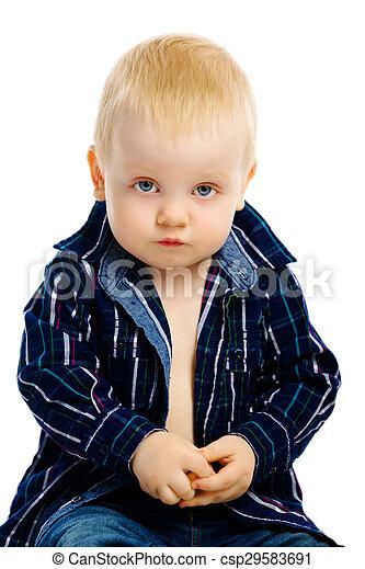 boy sitting on a white background - csp29583691