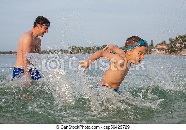 Boy Son Father Play Sea Splashing - csp56423729