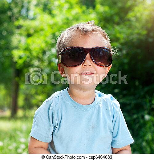 Boy Sunglasses in the summer park - csp6464083