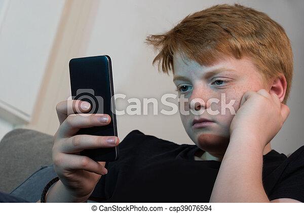 Boy Using Cellphone - csp39076594