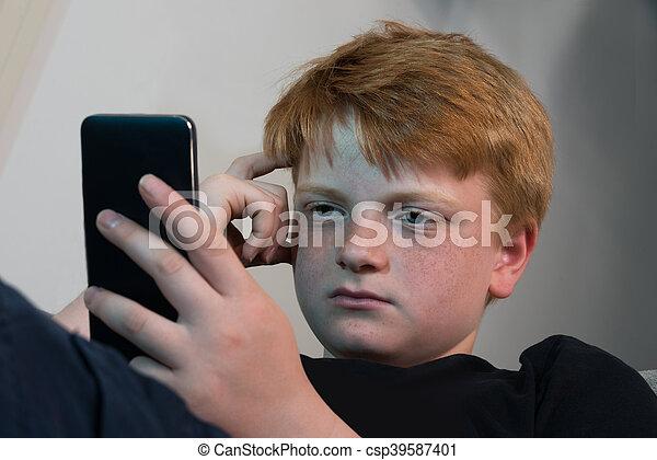 Boy Using Cellphone - csp39587401