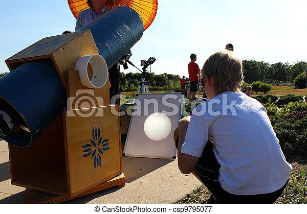 Boy watching the Venus Transit of Sun  - csp9795077