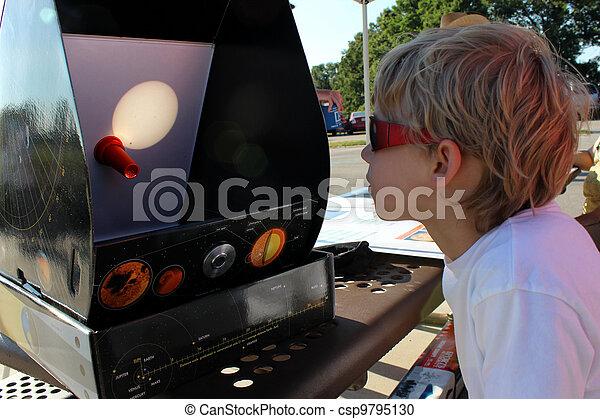 Boy watching the Venus Transit of Sun  - csp9795130