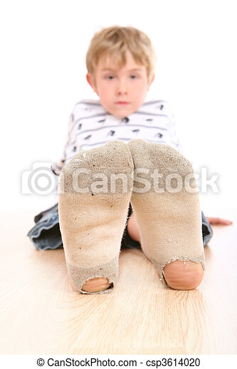 Boy wearing dirty socks with holes in them - csp3614020