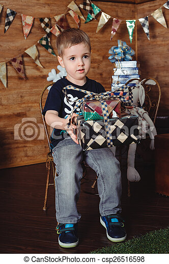 boy with a gift box - csp26516598