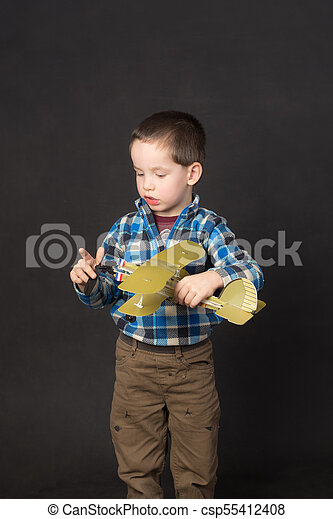 boy with a model airplane - csp55412408