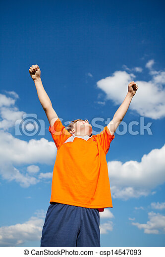 Boy With Arms Raised Celebrating Victory Against Sky - csp14547093