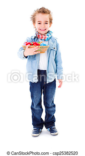 Boy with basket full of Easter eggs - csp25382520