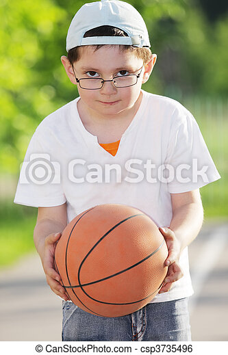 Boy with basketball - csp3735496