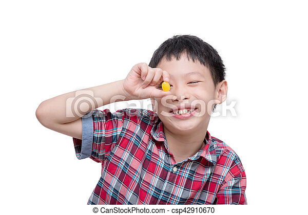 boy with candy isolated over white - csp42910670