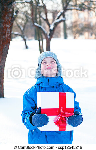 boy with Christmas present - csp12545219