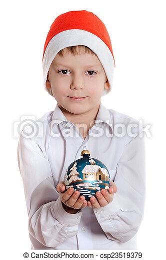 boy with christmas present - csp23519379