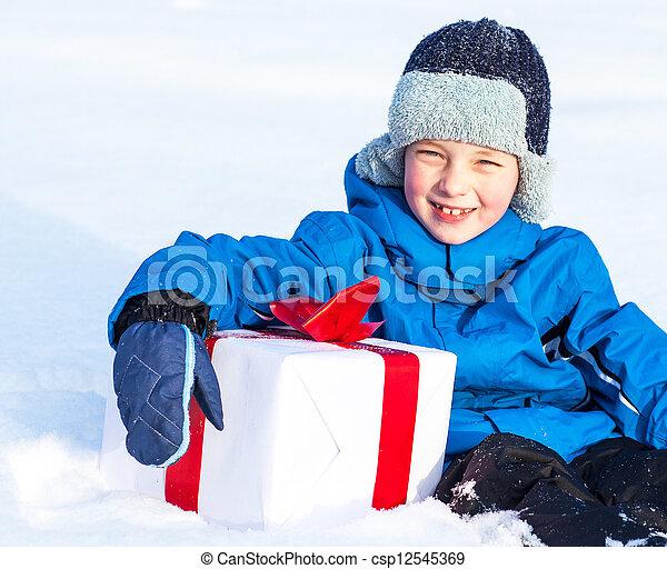 boy with Christmas present - csp12545369