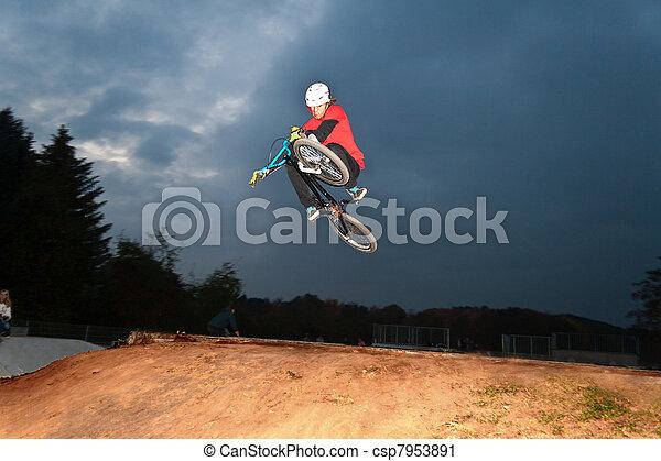 boy with dirt bike jumping - csp7953891