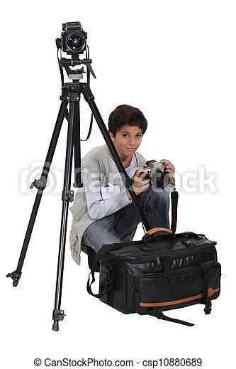 Boy with equipment of photographer - csp10880689