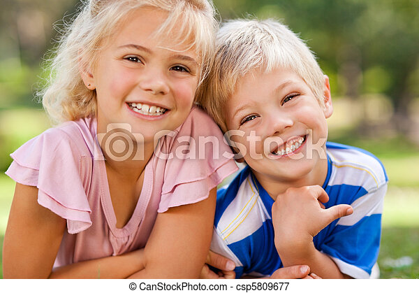 Boy with his sister in the park - csp5809677