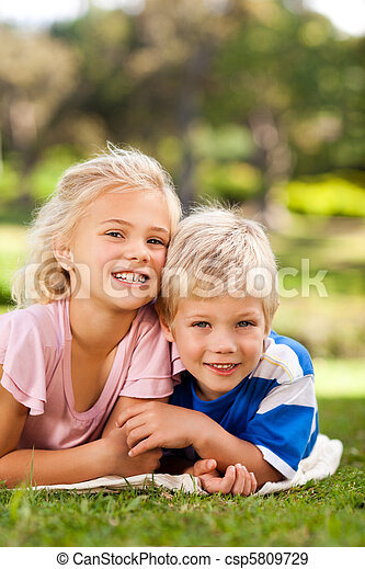 Boy with his sister in the park - csp5809729
