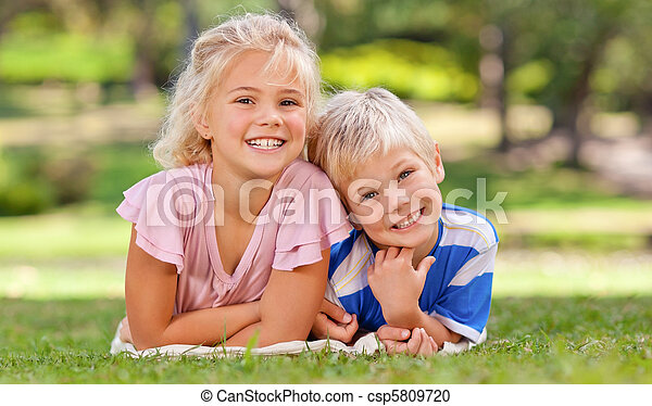 Boy with his sister in the park - csp5809720