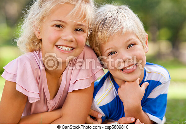 Boy with his sister in the park - csp5809810