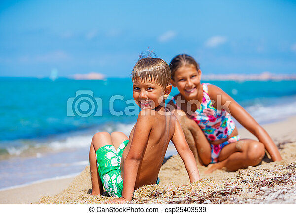 Boy with his sister on the beach - csp25403539