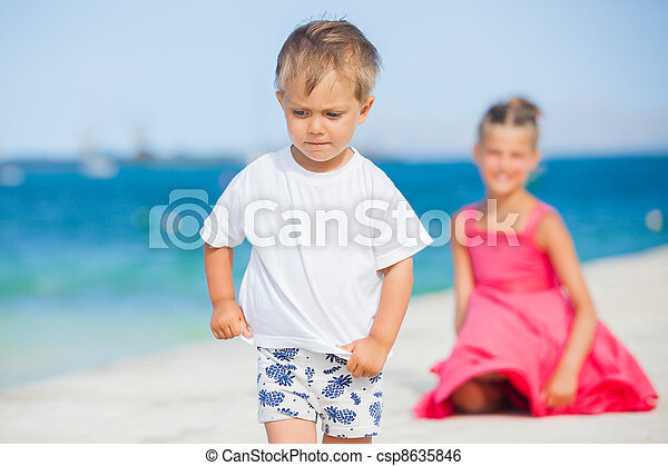 Boy with his sister walking on jetty - csp8635846