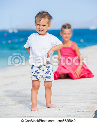 Boy with his sister walking on jetty - csp8635842