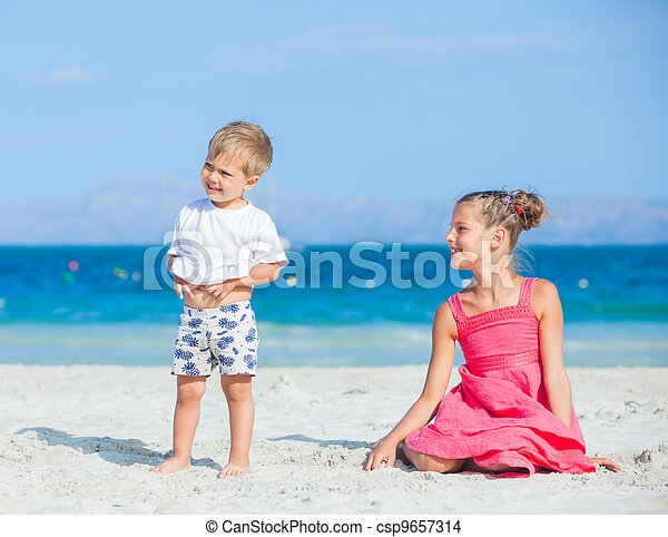 Boy with his sister walking on jetty - csp9657314