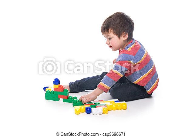 Boy with multicolored bricks - csp3698671