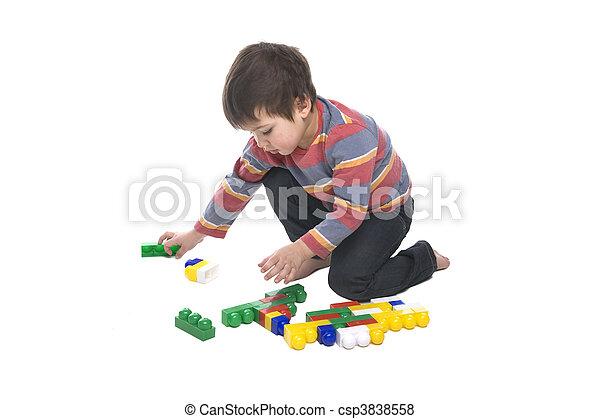 Boy with multicolored bricks - csp3838558