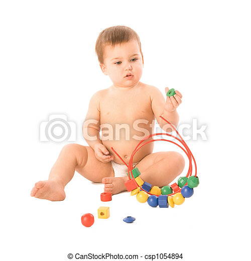 Boy with multicolored cubes - csp1054894