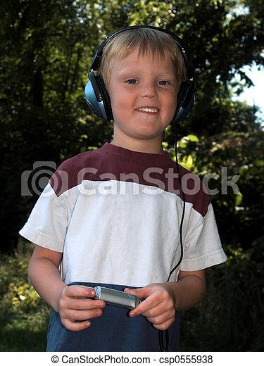 boy with music - csp0555938
