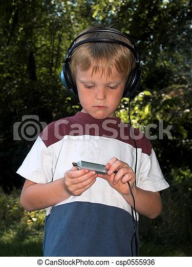 boy with music - csp0555936