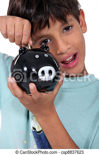 Boy with piggy bank - csp8837623